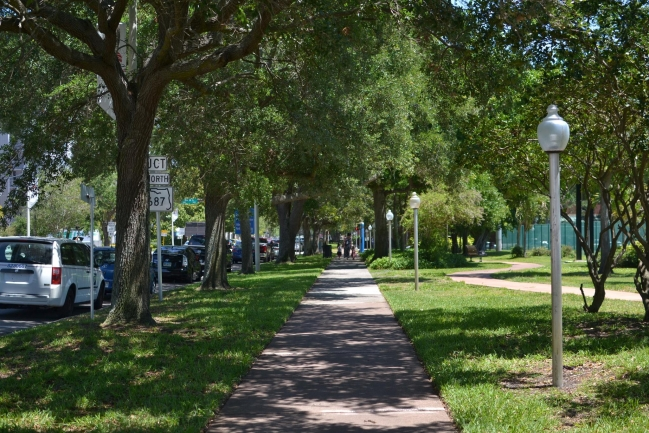 Walkways surrounding Beacon on Third in Downtown St Petersburg Florida are lined with lush landscaping